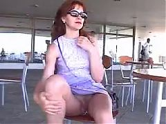 Mature lady revealing cunt at a cafe