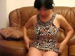 Mature asian woman dressing on cam stolen