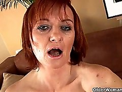 Slutty granny in stockings is dildoing her hairy pussy