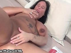 Busty horny housewife wanking her pussy on the bed and