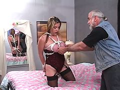 Sexy thick brunette is bound and fucked on the bed by an older dude