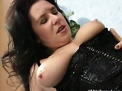 Brunette mature woman gets horny rubbing an hard cock o