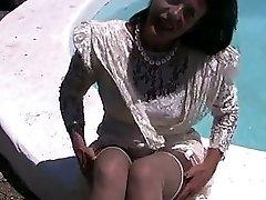 Fingering herself beside a pool
