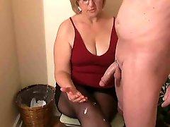 Mrs Watson gives her neighbour a handjob