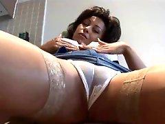Big tits mature babe in tight mini skirt posing