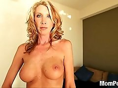Horny blonde MILF swallows cum
