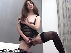 Horny brunette mature wife in sexy black stockings mast