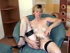 Hairy blonde mature rubbing her pussy