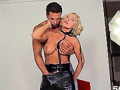 MILF photographer wearing patent belt seduces young model