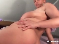 Huge tits mature brunette plays with her twat