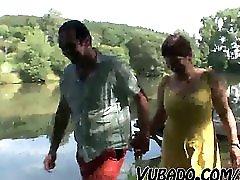 MATURE COUPLE HAVING OUTDOOR FUN