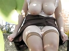 Natural young busty wife flashing in garden