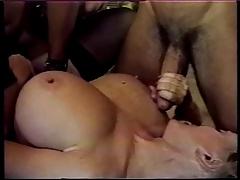 Two guys ram a big titty blonde