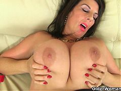 British milf Lulu works her big naturals and wet pussy