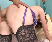 Busty mature plays with her tits then sucks cock